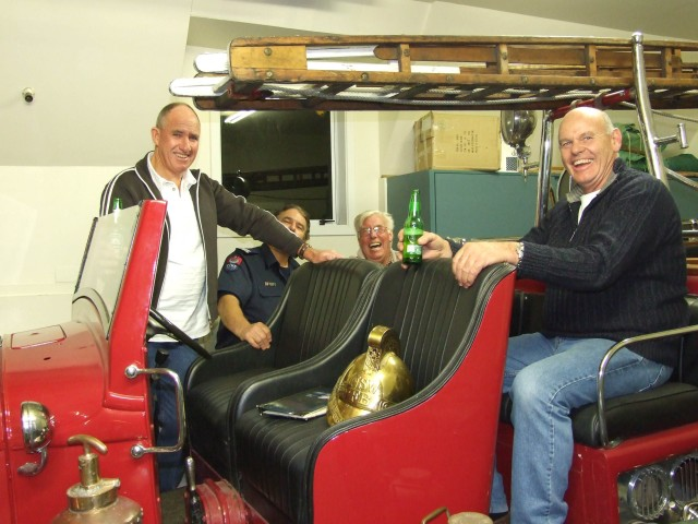 George Saunders , SFF John Forster,..... and former Chief Ron Casey check out the old Fordson.