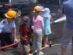 Station Officer Carl Mills and Firefighter Colin Vickery assist would-be firefighters at a Plimmerton School gala.