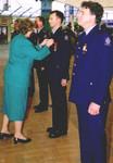 Porirua mayor Jenny Brash presents United Nations International Year of the Volunteer medals to Plimmerton firefighters.