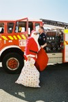 Station Officer Carl Mills delivers Santa to the Plimmerton Boating Club