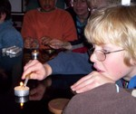 One Day School pupil Sasha Sneyd tries a pyrolosis experiment.