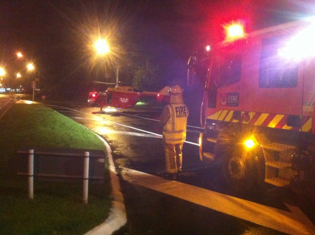 FF Bill Livett looks on as Westpac Rescue begins to unload in the landing zone created by Plimmerton 351