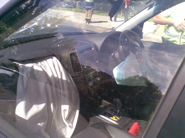 Both airbags deployed; passenger one broke the windshield