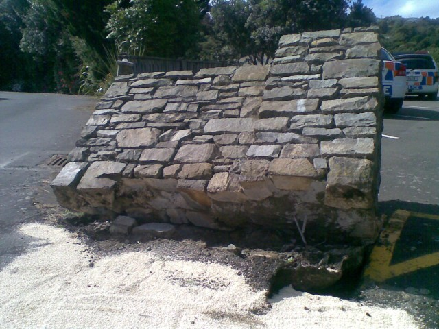 The entire wall was pushed nearly over, note the rebar ripped out of the foundation