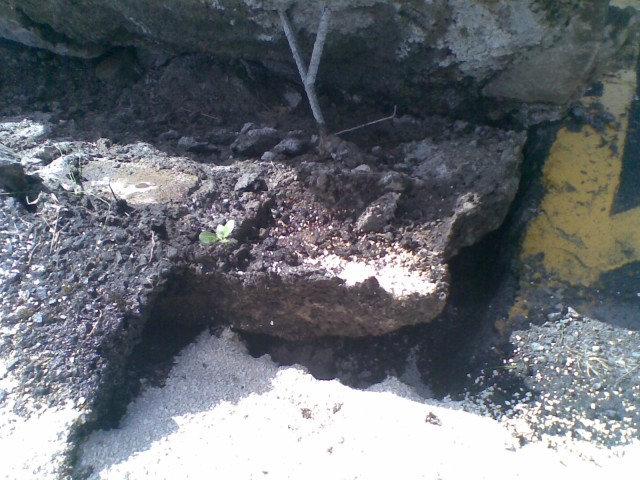 Closeup of asphalt lifted out of the ground