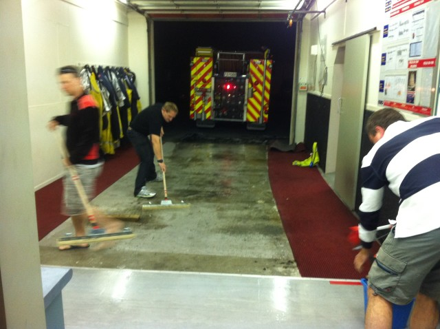 SFF Troy, QFF Langbein, FF Wootten attending to minor flooding on station