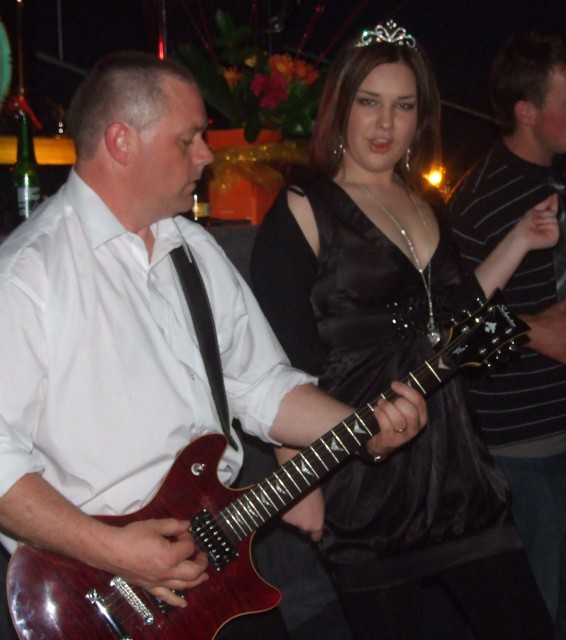 Firefighter Graeme Penty, lead guitarist for The Rock Factor, gets down on the floor with the revellers