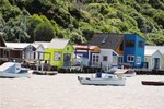 Boathouses of varying elegance along the Pauatahanui Inlet - once the refuge of poet Sam Hunt