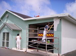 Two painters desperately hoping the siren doesn't go about now!!!  The fire station being converted to official NZ Fire Service livery of white with grey and red trim.