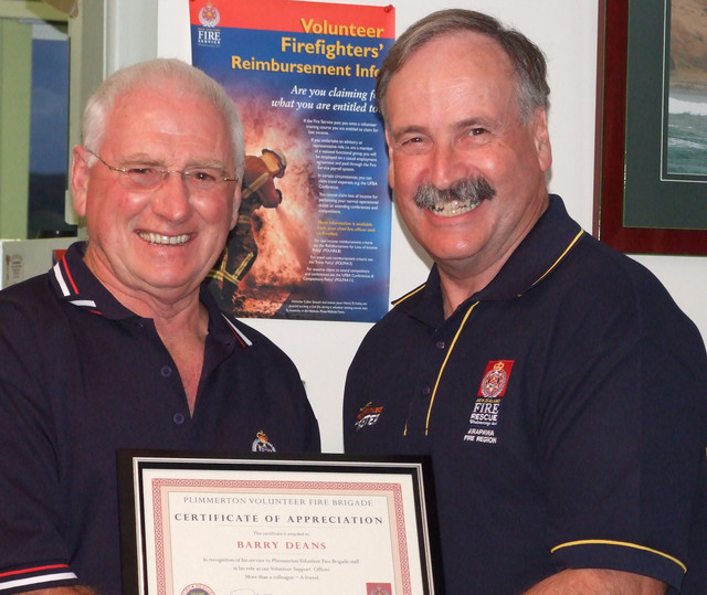Volunteer Suppport Officer for 17 years, Barry Deans (left), was farewelled at Plimmerton  with a social evening and a special certificate of thanks. Barry achieved his double gold star in 2007. Making the presentation is long-tern mate, Chief Russell Postlewaight.