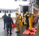 Firefighters suit-up for a chemical spill exercise at a Mana Cup competition.