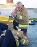 SFF Johnny Johnson applies elevation and compression to a severe wound during first aid refresher course.